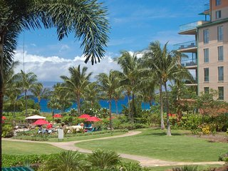Maui Resort Rentals: Konea 221 - Large Studio w/ Lush Courtyard and Partial Ocea
