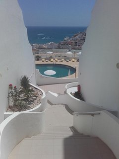 Entrance to our gated complex and looking down to pool. Fancy a dip?