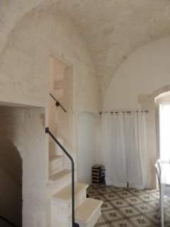 Stairs to roof terrace with beautiful exposed stone and ceilings