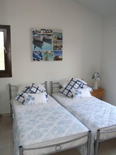 Upstairs twin room with balcony overlooking countryside and olive groves