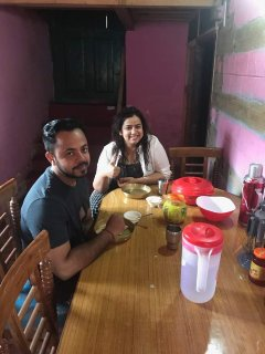 Guests enjoying Kinnauri cuisine.