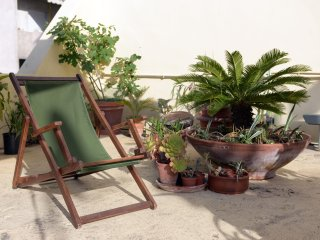 Sunny apartment with patio and roof garden