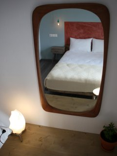 Mirrors over desks in all bedrooms