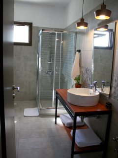 Well ventilated, minimalistic bathroom with shower cabin