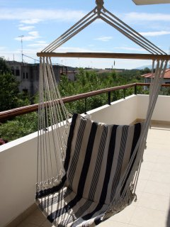A swing on the front balcony