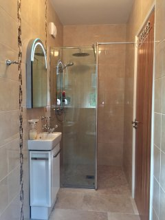 The ensuite bathroom attached to bedroom 2, includes a luxurious walk-in (no step) rainshower.