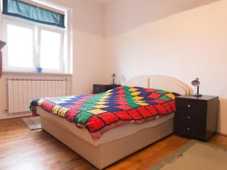 Spacious bedroom with double bed.