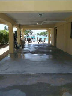 NEW street view thru carport to new 30' dock + entire length of 10/11th Sts. canal to OCEAN + GULF!
