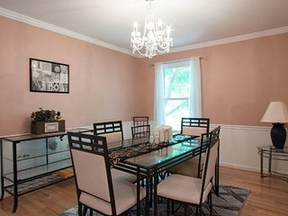 Luxurious 4 Bedroom Townhome with Patio and Garage