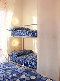 particolare della camera da letto: lettino a castello
