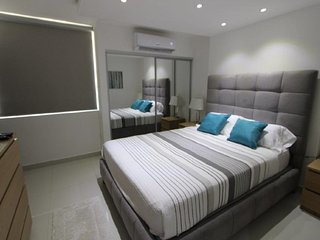 Condado, newly remodeled and modern pad one parking