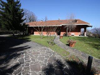 Villa Virginia immersed in the greenery overlooking Lake Iseo