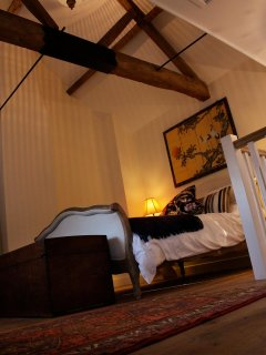 Characteristic high vaulted ceilings in the bedroom
