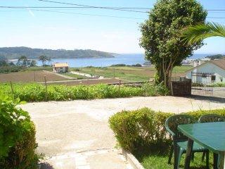 Apartamento con jardin, vistas al mar