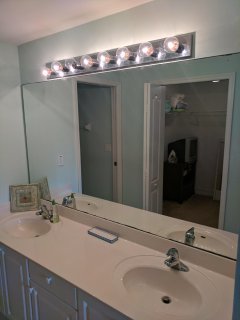 Master Bathroom with His and Hers Sinks and Walk-in Closet