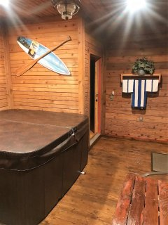Large enclosed back porch with new hot tub