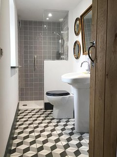 The downstairs shower room has grab handles, & low profile shower tray, idea for elderly guests.