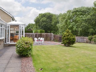 The fully fenced back garden with conservatory and lovely views.