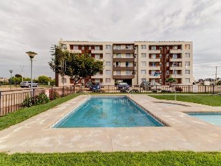 Peaceful condo w/ shared pool & balcony views just a short drive from the beach!