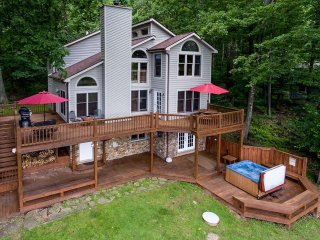 Perched among the treetops overlooking Deep Creek Lake, this cozy getaway makes