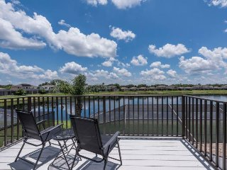 Gorgeous 4 bed south facing pool home overlooking Sunset Lake