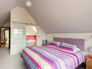 Master en-suite bedroom with king double, and views across to the Isle of Wight