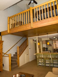 Stairway leads to master bedroom and loft.