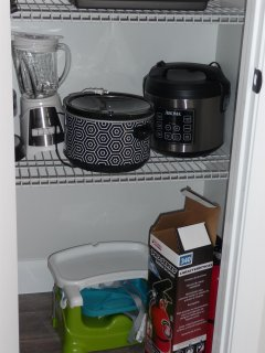 The pantry is full of small appliances, even a rice cooker