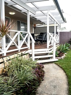 Sunny deck area with outdoor dining and barbecue...