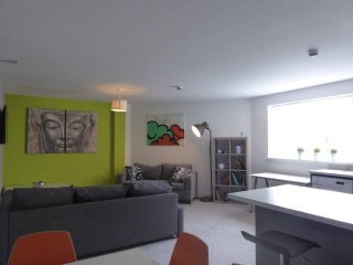 View of open planning living area from dining area