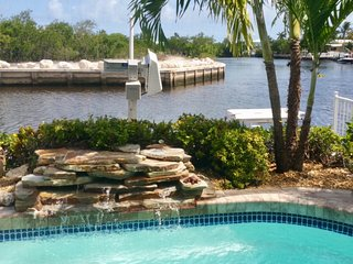 WOW – waterfront, boat lift, private heated pool, walk to beach and shops!
