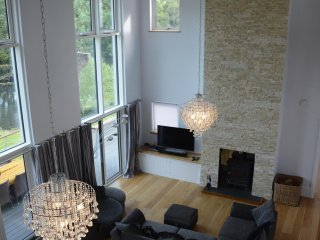 Huge luxury modern riverside home, dog friendly, private salmon fishing canoeing