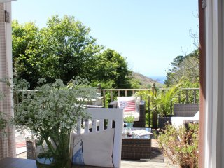 Charming cottage with lush gardens, large terrace & sea views