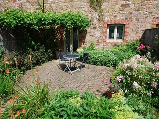 In an afternoon or evening  the west-facing sun-trap patio and garden is an inviting place to relax.