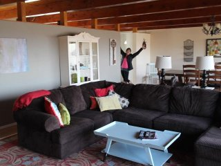 Spotlessly clean, comfortable, beautiful light filled living room and dining room with city view!
