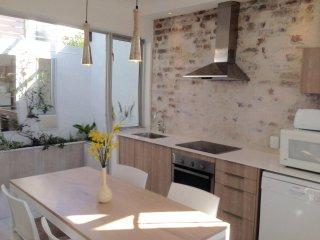 modern kitchen opening onto herb garden