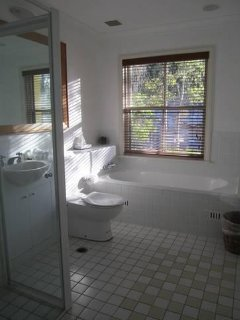 Light and airy ensuite with views of natureland
