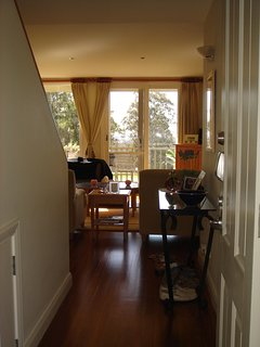 front door view looking through lounge room to golf course