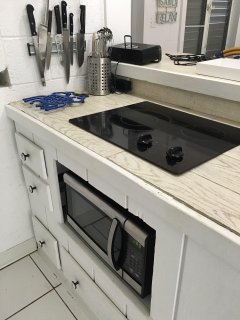 Built in Cooktop & Microwave with all utensils & cookware provided.