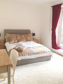 Main bedroom with comfy double bed.