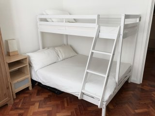 Comfortable double and single bunk bed in main bedroom.