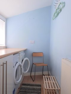 Utility room with washing machine/tumble drier