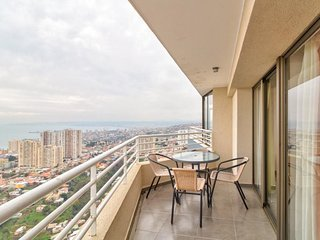 Modern condo with stunning ocean views, patio, and shared pool