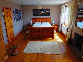 Master bedroom with log burner