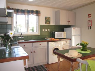 Fully equipped kitchen with clothes washer