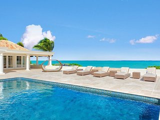 BEAU RIVAGE...well designed beachfront 3BR villa provides exceptional vistas of