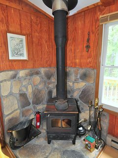 In the cooler months, curl up with a good book by the wood stove.
