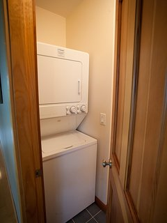 Stacked washer and drier in shared bathroom
