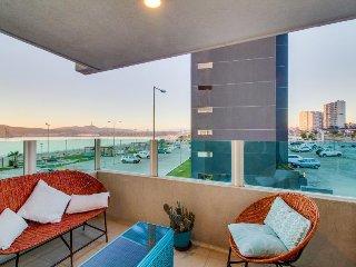 Modern, welcoming condo w/ shared pool, balcony, & ocean views - walk to beach!