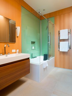The skylighted en suite bathroom of the South bedroom also has a Jacuzzi tub and heated towel rack.